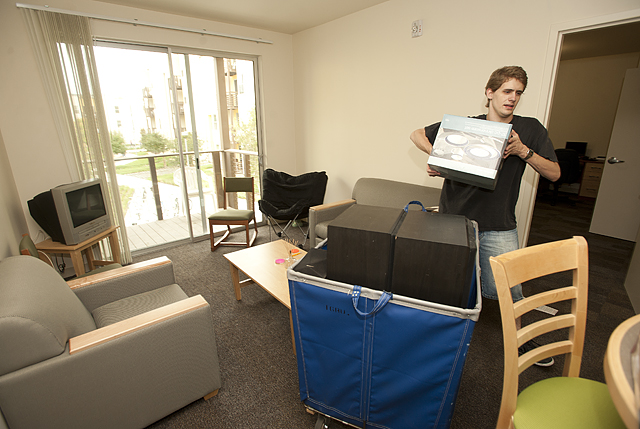 Chris Bullock, a junior mechanical engineer, moves into his room at the new suites at Cal Poly Pomona.