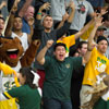 Billy Bronco and Students cheering at a basketball game