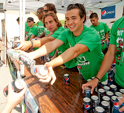 The men's soccer team hands out drinks during the 2011 Hot Dog Caper at Cal Poly Pomona September 27, 2011.