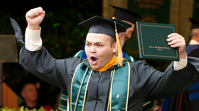 A College of Agriculture graduate celebrates at commencement in 2011.
