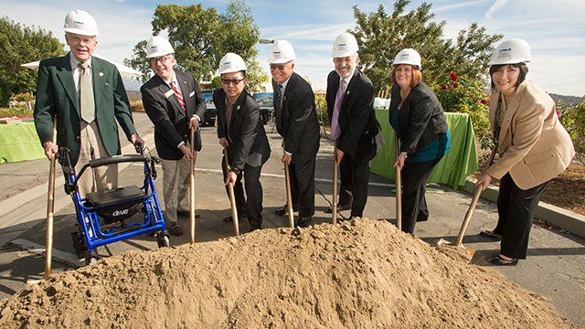 Jim Collins, Ed Merritt, Eugene Park, Hae Park, President Michael Ortiz, Mary Niven and Bridget Bilinski celebrate the groundbreaking of the The Collins College of Hospitality Management's $10 million expansion on November 7, 2013.