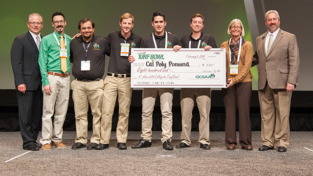 One of two Cal Poly Pomona teams receives a check for its fourth-place finish at the 20th annual Collegiate Turf Bowl in Orlando, Fla.
