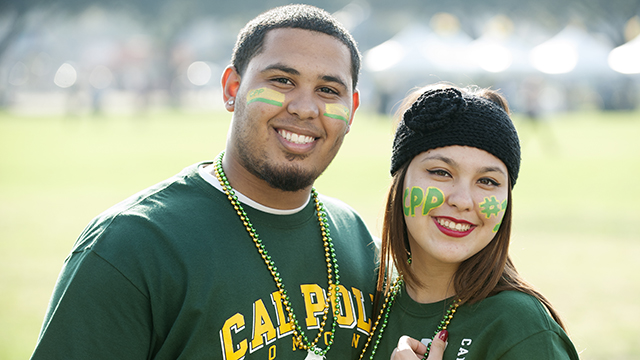 Students get into the spirit at Cal Poly Pomona's homecoming festivities by getting their faces painted.