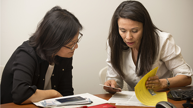 Accounting major Ana Rodriguez, right, helps Grace Lee with her taxes during Tax Day last year at the College of Business Administration.