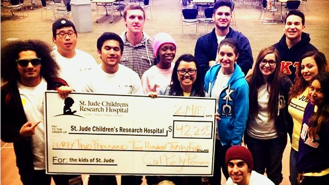 Students Posing with Check