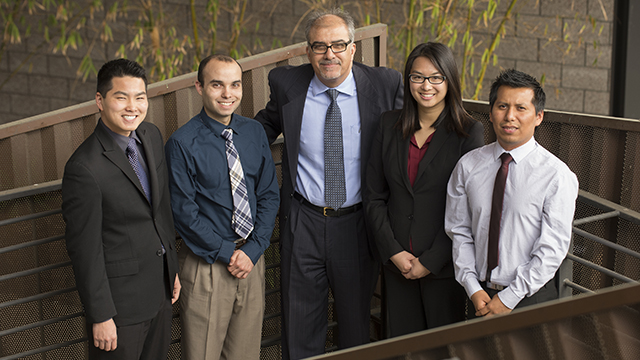 Led by finance Professor Majed Muhtaseb, center, a team of Matt Yamamoto, Michael Lovett, Jia-Lie Wu and Omar Benitez won the first round of the CFA Institute Research Challenge, an international investment research competition.