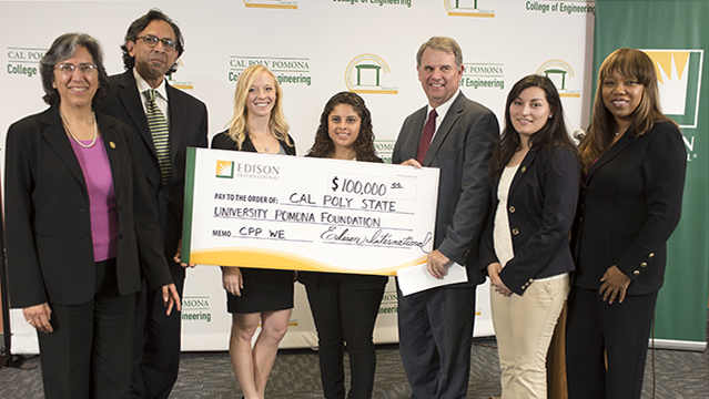 David Mead, senior vice president of Edison's Transportation and Distribution Business Unit, presents a check to College of Engineering Dean Mahyar Amouzegar, Associate Dean Cordelia Ontiveros and other Cal Poly Pomona students during the Edison International Women in Engineering Program.