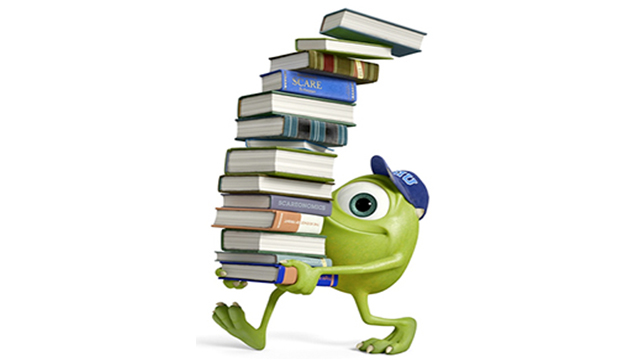 "Mike Wazowski, from the Disney and Pixar movie ""Monsters, Inc.,"" carrying a stack of books."