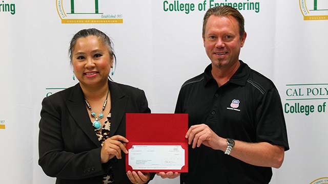 Brent T. Litjen, senior recruitment manager for Union Pacific's Los Angeles Service Unit, presents a check for $5,000 to Lily Gossage, Maximizing Engineering Potential (MEP) director.