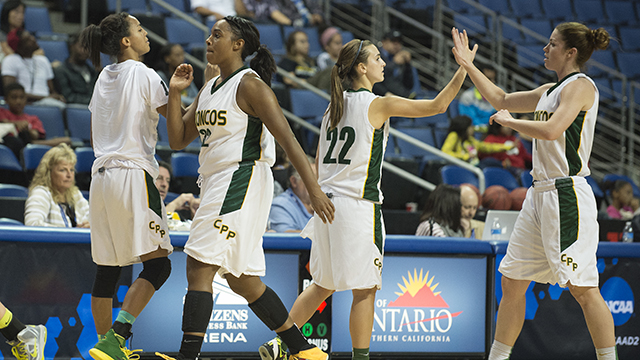 Members of the women's basketball team high five each other during a win over Cal State Los Angeles in the CCAA tournament.