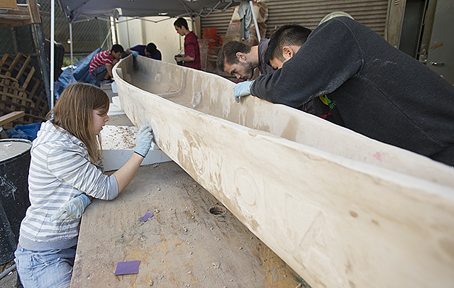 Members of the concrete canoe team work on this year's boat, Gidget, as they get ready for their competition in San Diego next month.