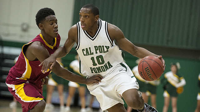 Barry Bell drives with the ball during the Bronco men's basketball team's  win over Cal State Dominguez Hills at Kellogg Gym.