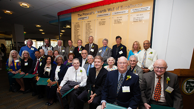 Past winners of the Provost's Awards for Excellence and the Outstanding Professor Award at a March 14 ceremony unveiling a new permanent display honoring them.