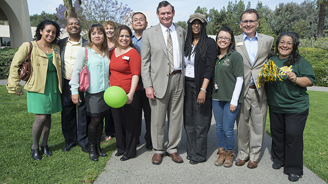 Student Affairs staff pose with CSU Chancellor Tim White during his visit last year to Cal Poly Pomona.