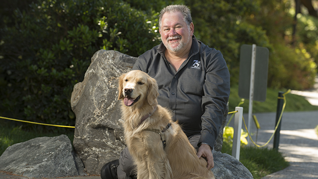 Professor Aubrey Fine with his dog, Ketzy at the Aratani Japanese Garden at Cal Poly Pomona.