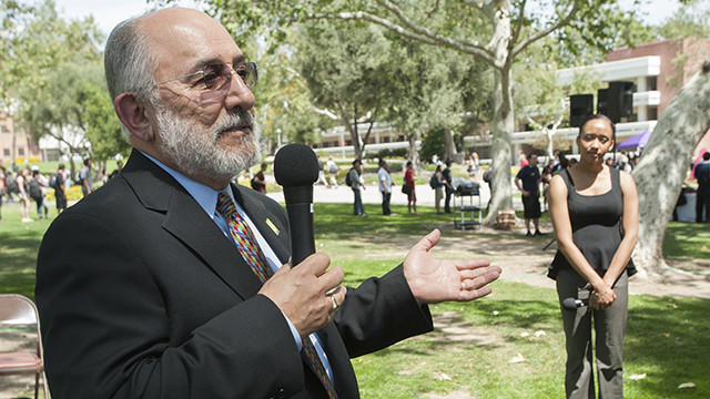 University President Michael Ortiz answers a question while ASI President Christine Hall during the Spring 2014 Pizza with the Presidents out on the quad.