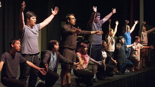 "Students rehearse ""Urinetown: The Musical,"" a Music Theatre Workshop production that will be performed May 8-10."
