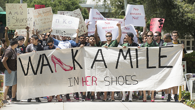 "Students participate in the ""Walk a Mile in Her Shoes"" march against violence at Cal Poly Pomona."