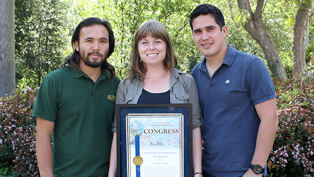 Tony Deveyra (left), Emily Creegan and Lucio Zepeda pose with a certificate of congressional recognition for teaching San Bernardino County residents urban farming techniques.