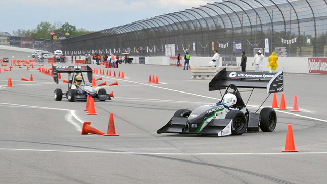 The Cal Poly Pomona Formula SAE race car on the race track.