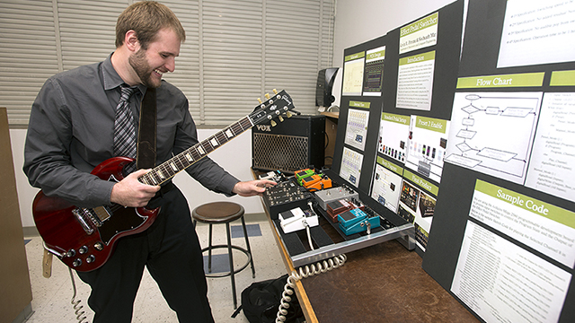 Engineering student Kevin Pirrone demonstrates his effects pedal switcher at the 2014 Engineering Project Symposium at Cal Poly Pomona May 30, 2014. Over 100 student teams showed off projects and competed for prizes.
