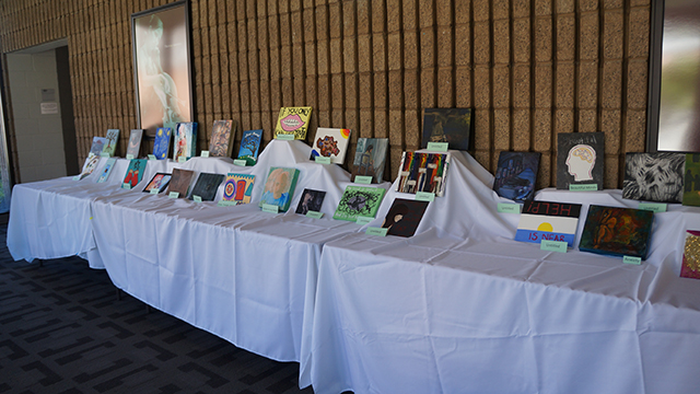 Some of the works displayed on a table at the Art With Impact event in May. The event was intended to break the stigma attached with mental health and promote discussion within the campus community.