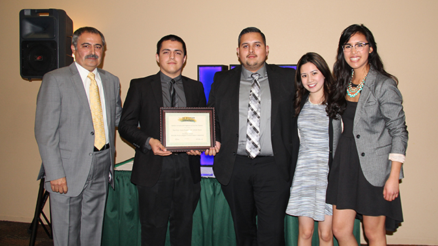 Professor Kamran Abedini, Paul Nava, Alfredo Munoz, and Institute of Industrial Engineering student chapter officers, Arianne Maristela, and Crystal Chea. Nava and Munoz were part of a team that took first place in the IIE Western Regional Conference and Technical Paper Competition.