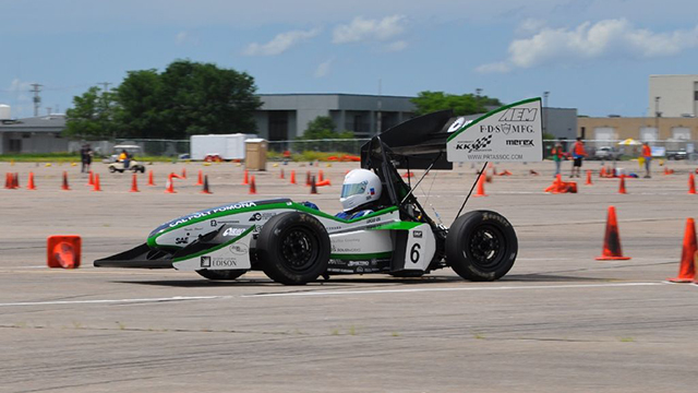 The Cal Poly Pomona Formula SAE team's car on a racetrack.