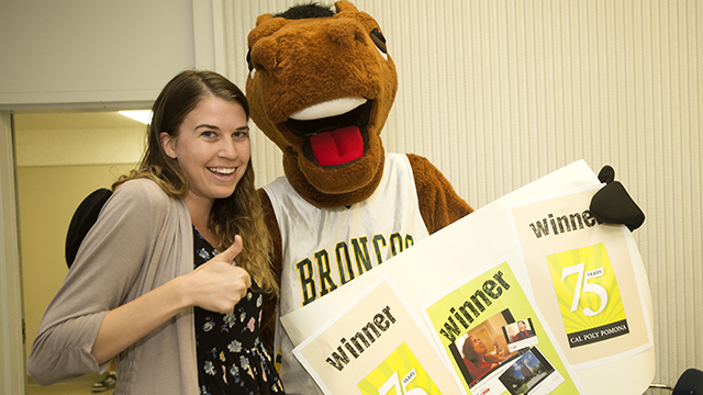 Abigail Inman, winner of the 75th Anniversary video contest, poses with Billy Bronco and gives a thumbs up.
