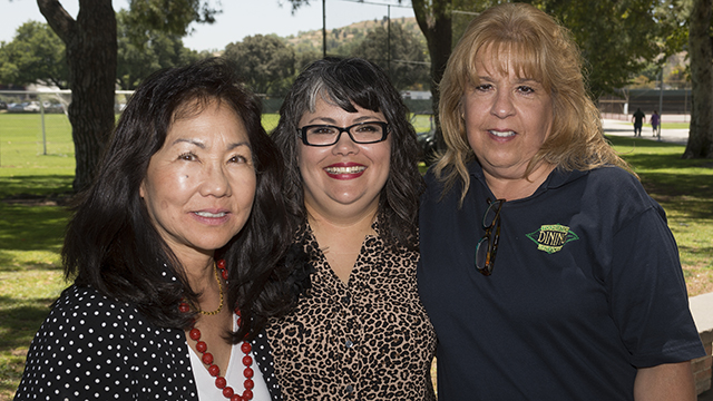 From left to right, Adeline Yoshioka, Marissa Martinez and Carol Couchman were among those honored with the 2014 Outstanding Staff Awards. Not pictured: Carol Lee.