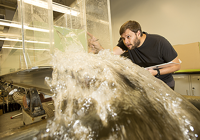Anthony Kreeger, a civil engineer, takes measurements during his Hydraulics lab at Cal Poly Pomona.