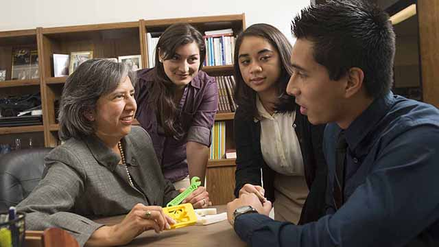 Associate Engineering Dean Cordelia Ontiveros talks with students at the College of Engineering.