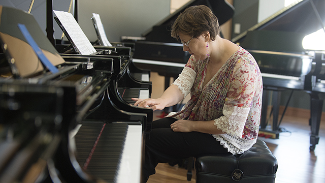 Music Professor Nadia Shpachenko tries out a piano at the Steinway & Sons showroom in Pasadena on June 23.