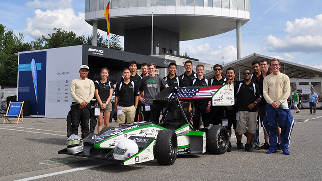 The Cal Poly Pomona Formula SAE team poses with its car. The team finished ninth in an international competition in Germany.