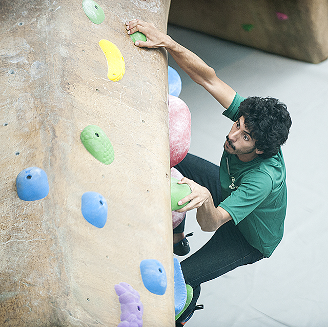 Eric Santos climbs on the climbing wall at the BRIC at Cal Poly Pomona.