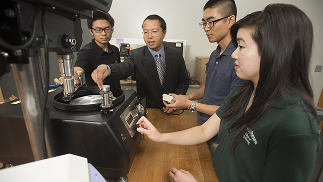 Mechanical Engineering Professor Yong Gan with students in his lab. The new Engineering Scholars Program will give $5,000 scholarships annually to 20 academically gifted engineering students who are minorities or females and who are the first in their families to attend college.