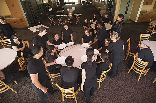 Students in the Food and Beverage Operations II class at the Collins College of Hospitality Management learn the proper way to serve at a banquet at the Restaurant at Kellogg Ranch.