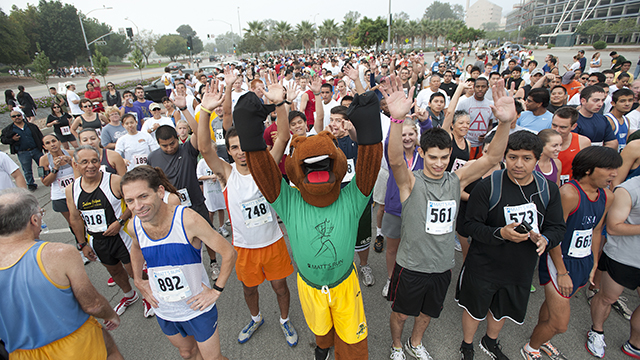 Billy Bronco waves before the Matthew Myers Memorial 5K run at Cal Poly Pomona.