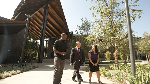 Dean Richard Lapidus, center, at the College of Business Administration complex.