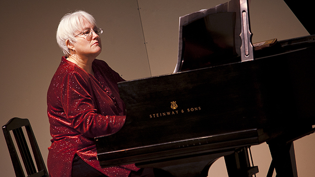 Janet Noll plays the piano in the Cal Poly Pomona Recital Hall.