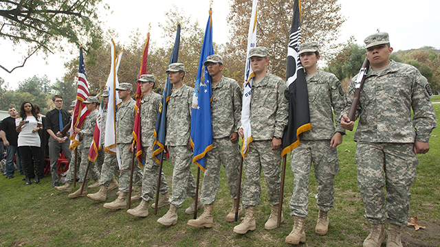 ROTC cadets carry the United States flag and the flags of the various military branches during Veterans Day ceremony at Cal Poly Pomona November 8, 2012.