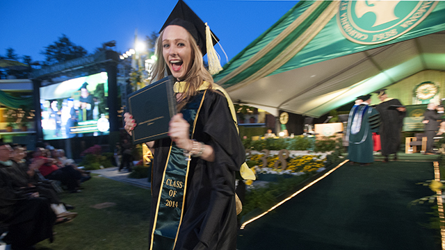 Student after receiving her hood at a Cal Poly Pomona commencement ceremony.