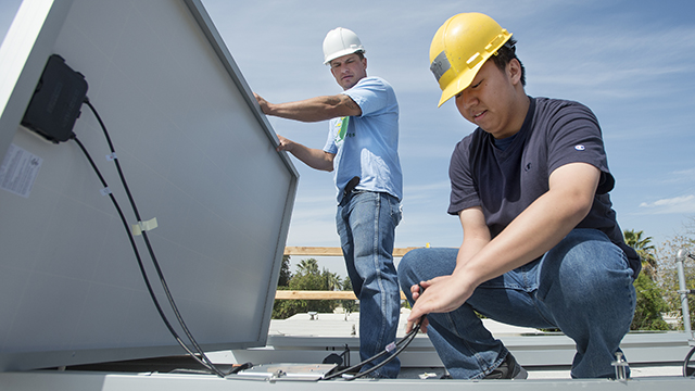 Cal Poly Pomona students helped install solar panels on homes as part of the 75 Acts of Kindness.