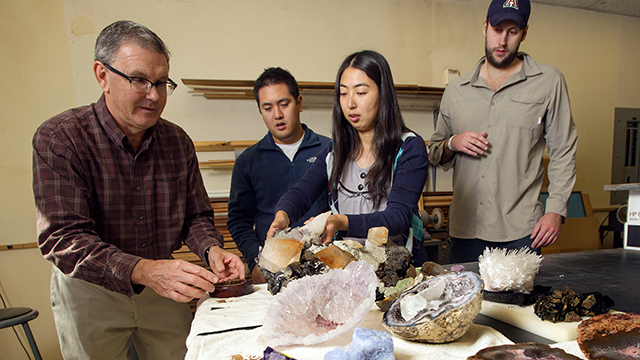 Cal Poly Pomona students unpack gems and rocks donated by accounting alumnus Roark Moudy to the College of Science.