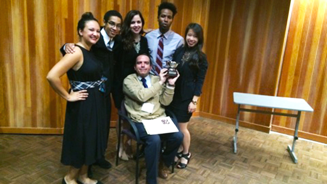 A Cal Poly Pomona team of (left to right) Lea Aguilera, Mathew McGuthry, Briana Capshaw, Shandyn Pierce, Grace Nguyen and (seated) coach/Philosophy Professor Michael Cholbi took second place in the California Regional Ethics Bowl competition in Santa Barbara on Dec. 6. The team heads to the national finals in Costa Mesa on Feb. 22.