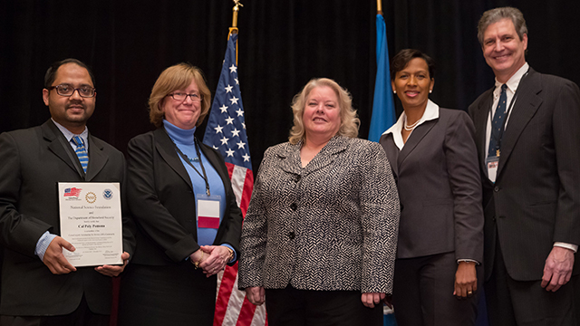 Assistant Professor Mohammad Husain, National Science Foundation's Education & Human Resources Assistant Director Joan Ferrini-Munday, U.S. Office of Personnel Management Chief Information Officer Donna Seymour, the Department of Homeland Security's CyberSkills Initiative Executive Director Renee Forney, and Computer Science Professor and Chair and Professor Robert Kerbs at the grant award ceremony.