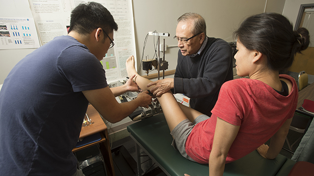 Professor Michael Liang and graduate student Nelson Kwoh ready Kathy Kim for a bone density test at Cal Poly Pomona.