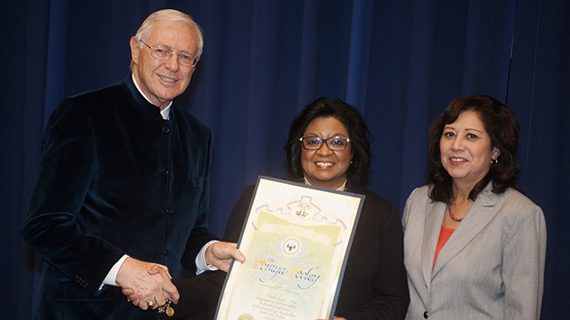 Los Angeles County Supervisor Michael Antonovich, left, presents President Coley with a proclamation recognizing her appointment at Cal Poly Pomona. Supervisor and Cal Poly Pomona alumna Hilda Solis, right, joined in the ceremony.