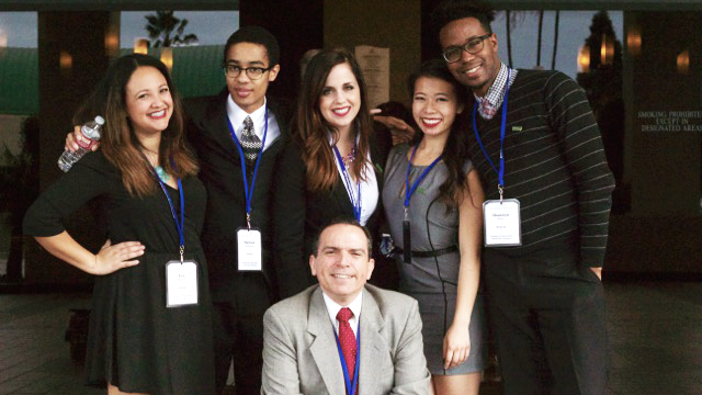 The Cal Poly Pomona Ethics Bowl team finished in the top eight at a national competition. The team is featured with its advisor, Philosophy Professor Michael Cholbi.