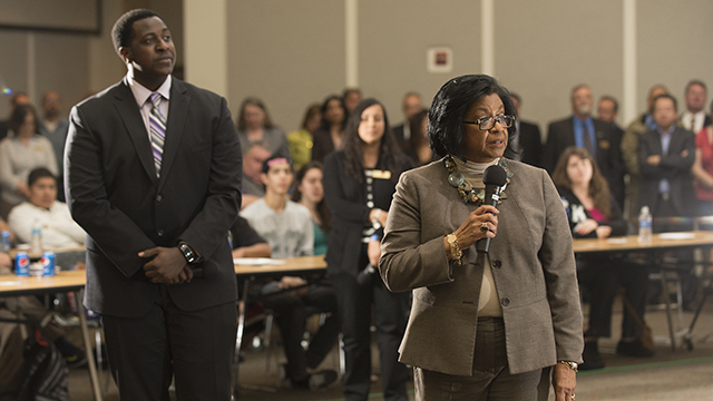 "Cal Poly Pomona President Soraya M. Coley answers a question at the winter quarter ""Pizza with the Presidents"" event, while ASI President James Cox looks on."
